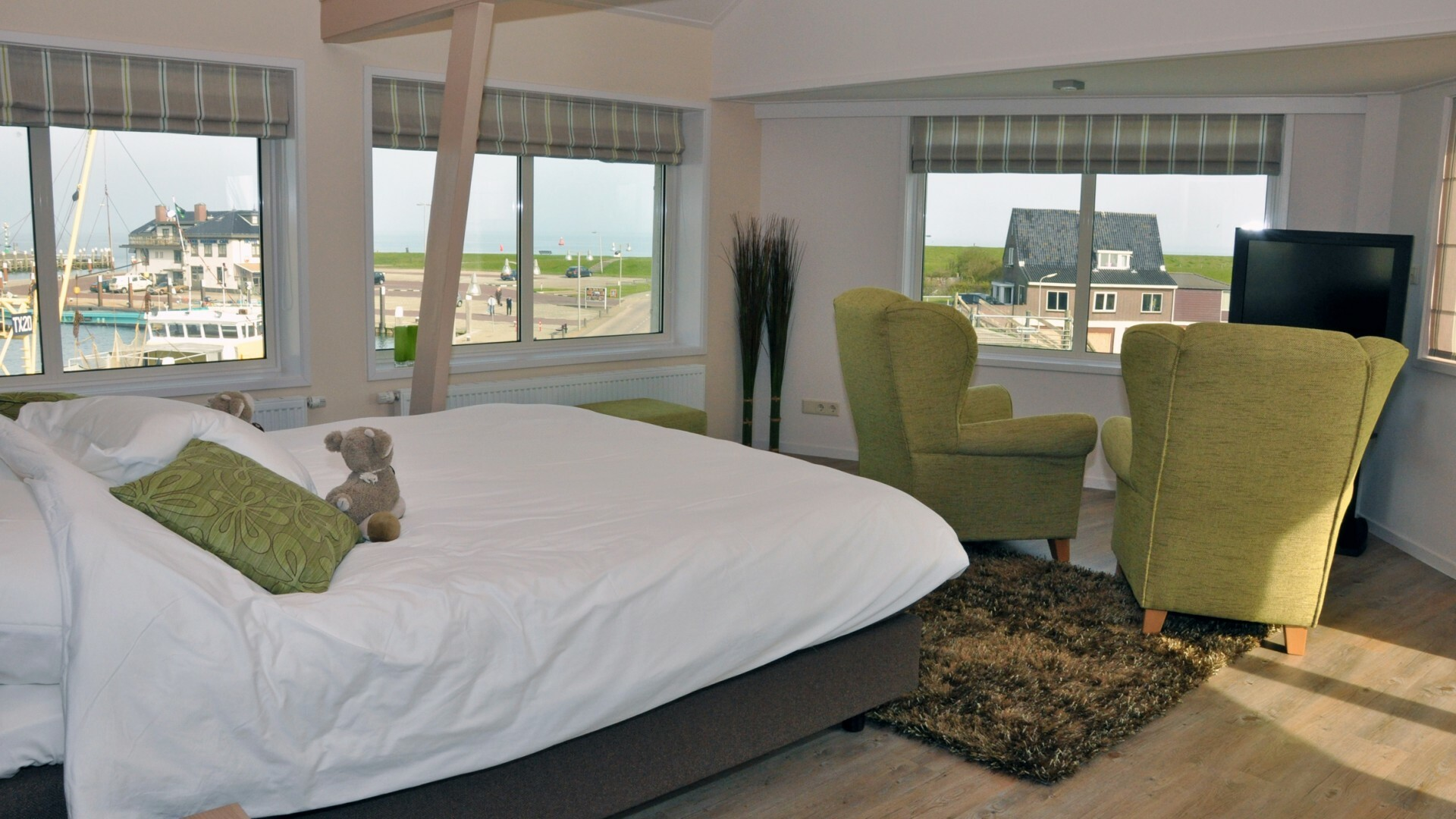Slaapkamer De Schapenboet bij hotel Havenzicht VVV Texel