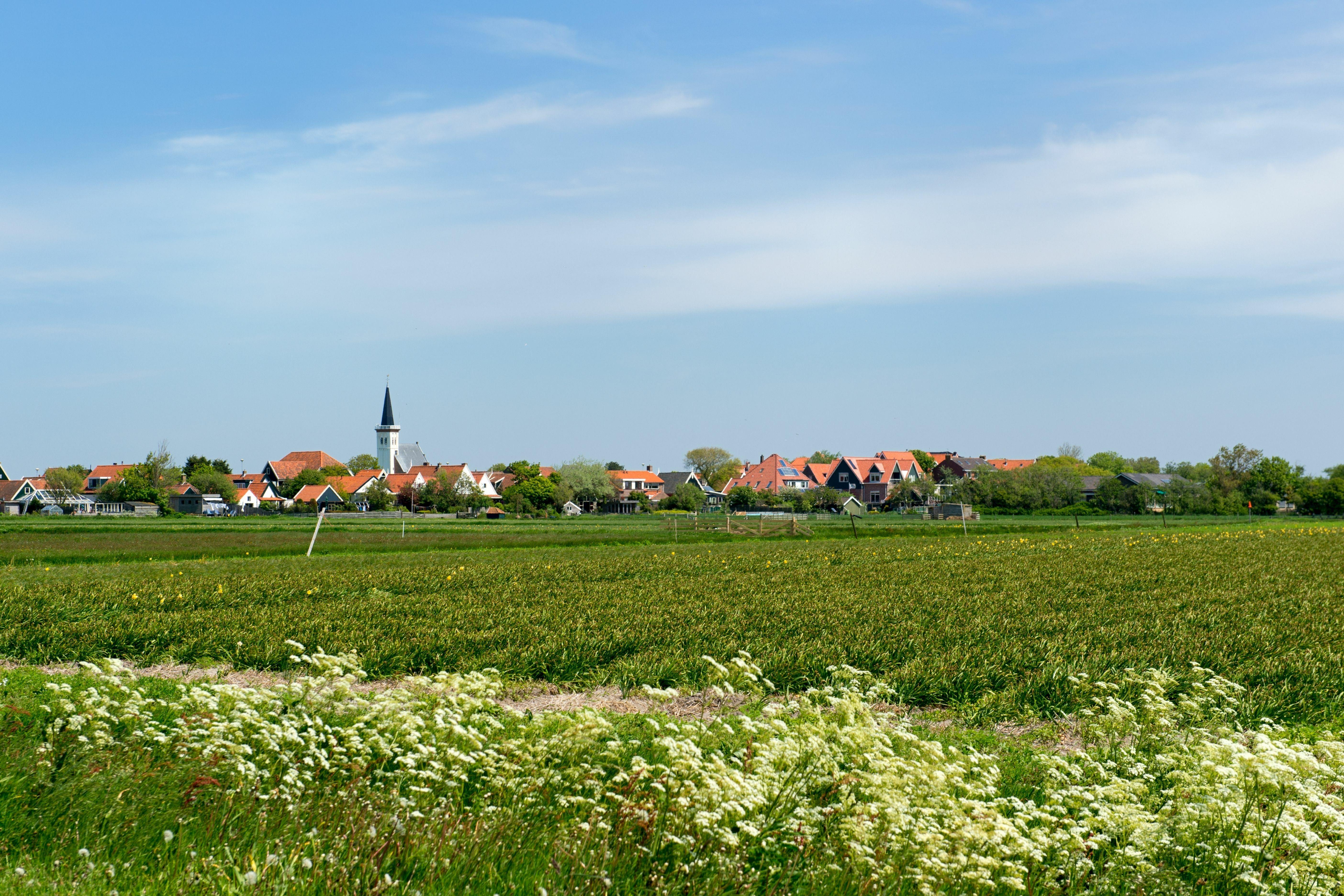 Uitzicht over de landerijen naar Den Hoorn VVV Texel