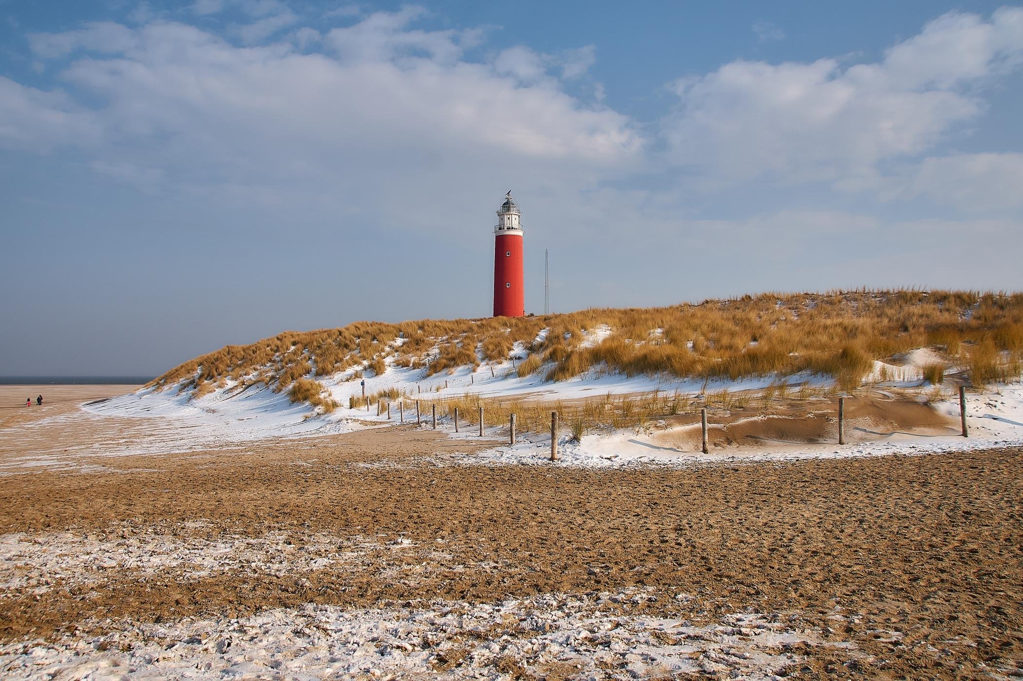 Vuurtoren in de sneeuw fotograaf Justin Sinner VVV Texel